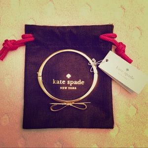 Kate Spade New York shiny gold bow metal bracelet